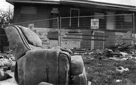 Image of an abandoned duplex in a lot adjacent to the d'Corize condo site in Surrey, BC.
